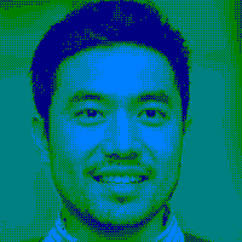 smiling man in shirt on navy turquoise palette amstrad colors