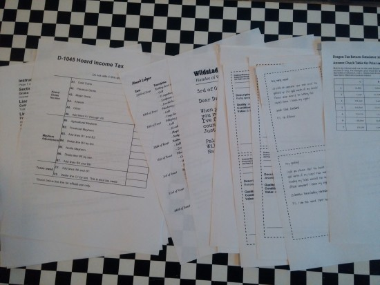 Printed out pages of dragon tax documents spread out across a table.