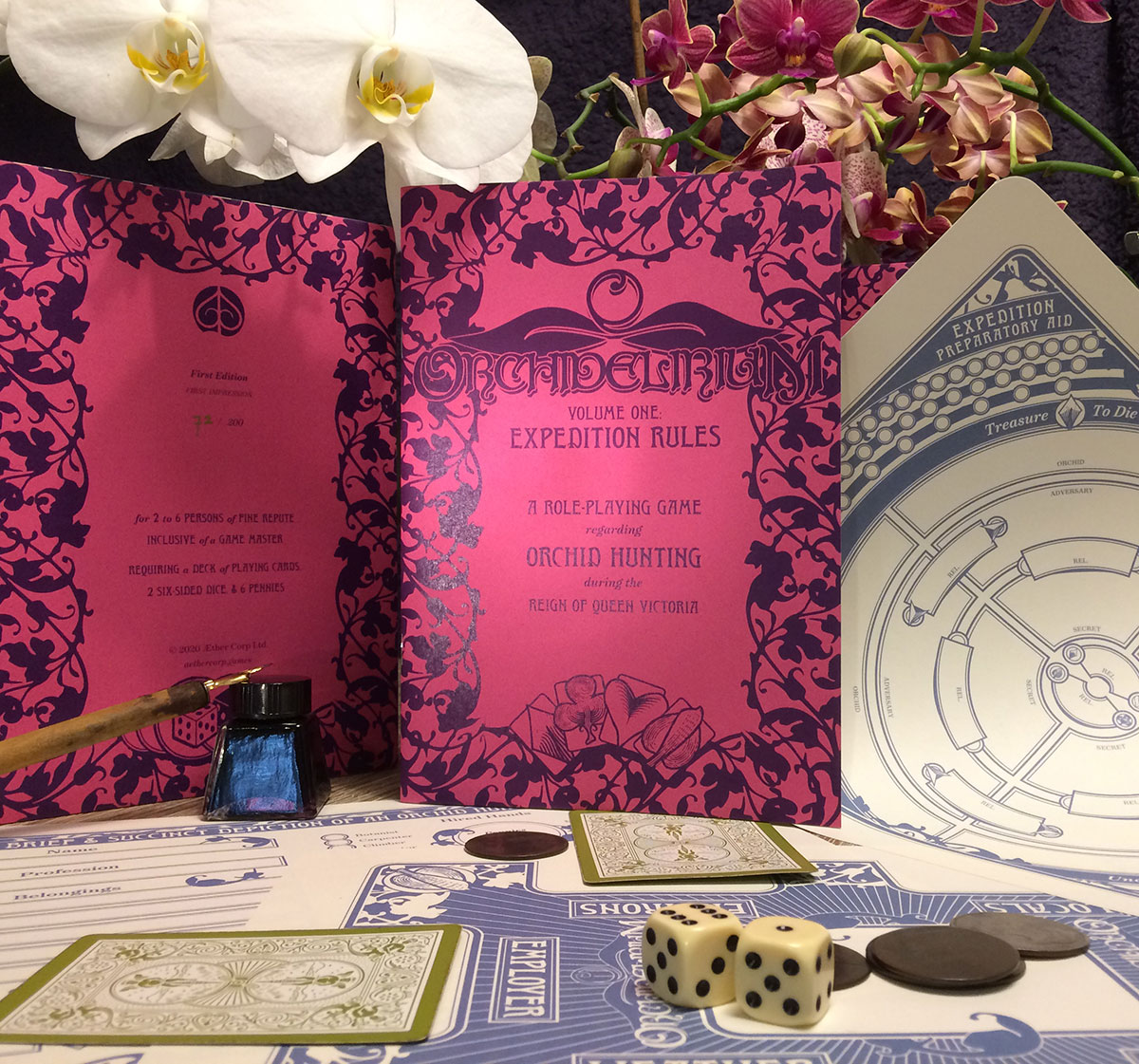 Photo of first edition zine with pink cover surrounded by orchids and print outs
